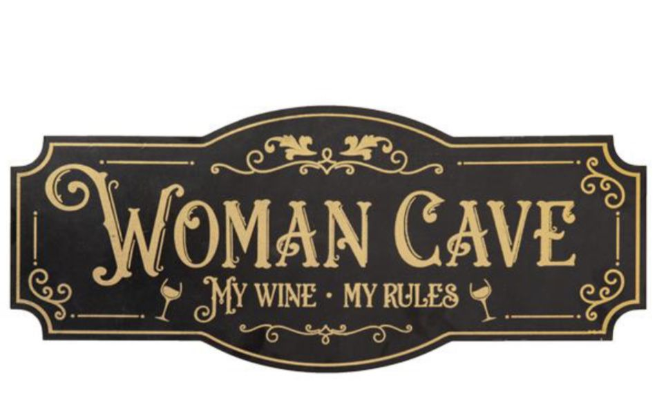 woman cave sign