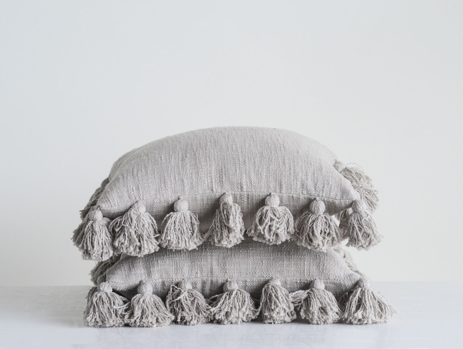 grey tassel pillow