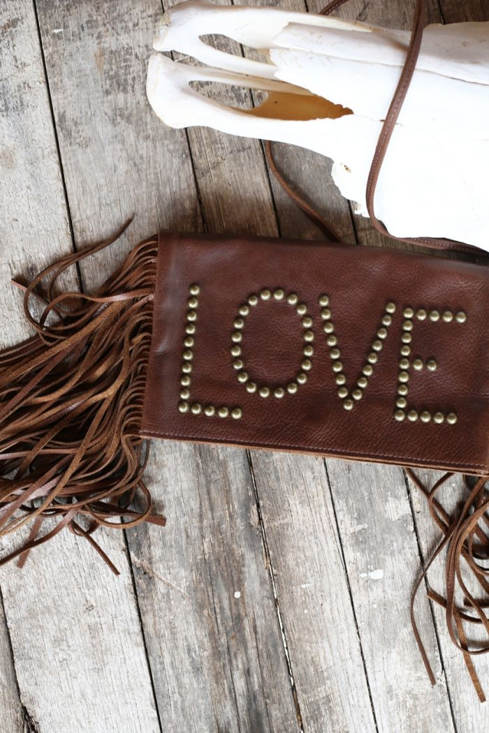 studs & fringe love clutch by mcfadin