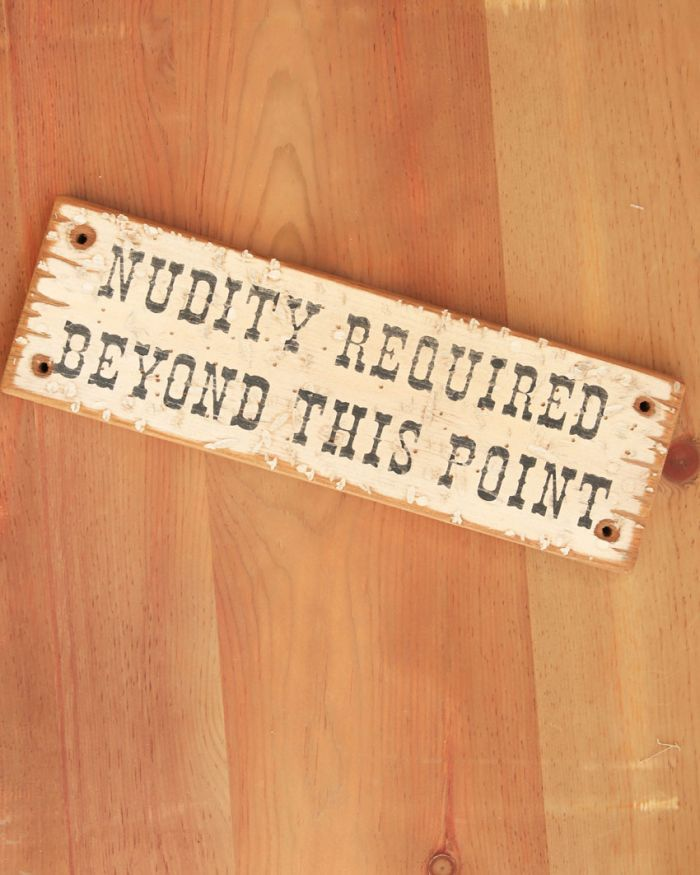 nudity required sign