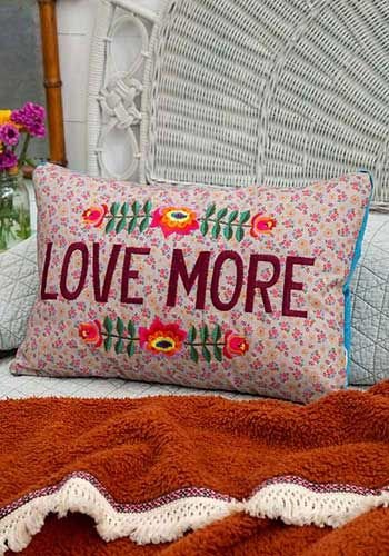 love more embroidered pillow
